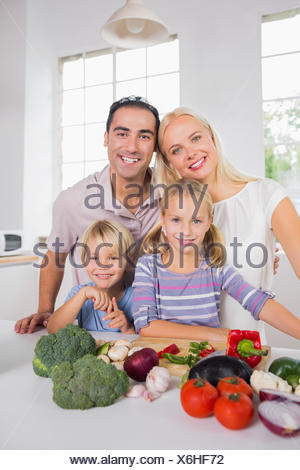 Happy posing family preparing a dinner - Stock Photo