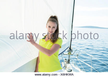 Young woman on sailboat, Adriatic Sea - Stock Photo