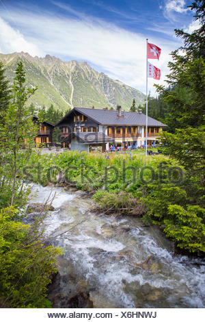 The Relais d'Arpette, a mountain hut near Swiss Champex, on the Tour du Mont Blanc, a classic multi day hike that goes through France, Italy and Switzerland. - Stock Photo