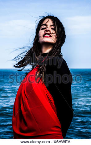 Portrait of a young woman by the sea - Stock Photo