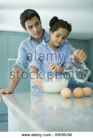 Father and daughter cooking together - Stock Photo