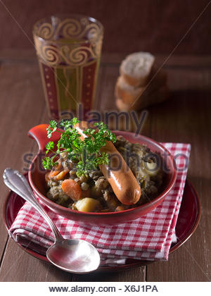 Lentil soup with sausages in a bowl - Stock Photo