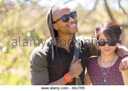 Romantic young couple strolling in woods - Stock Photo