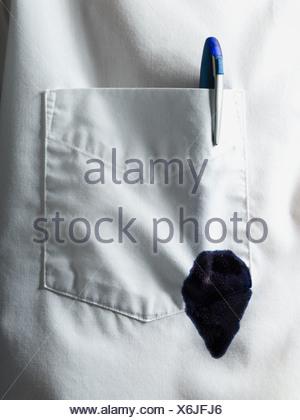 Leaking pen in pocket - Stock Photo