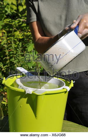 Mixing of a manure in a garden - Stock Photo