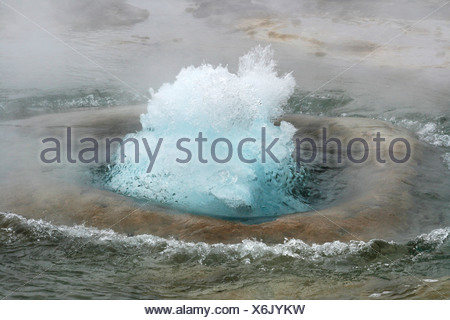 Strokkur Geyser shortly before eruption, geothermal region of Haukadalur, Geysir, Iceland, Europe - Stock Photo