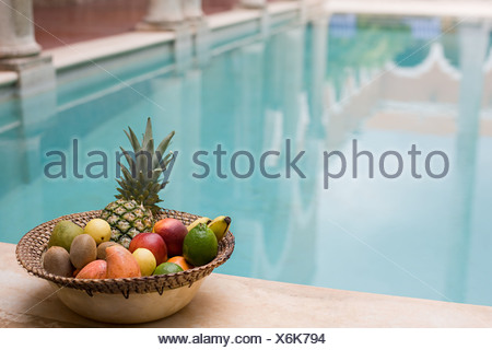 Fruit by swimming pool - Stock Photo