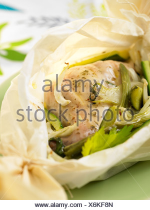 Chicken and asparagus cooked in wax paper - Stock Photo