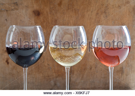 Rose, white and red wines in glasses Stock Photo