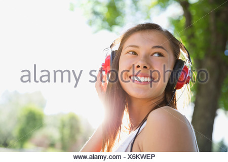 Teenage girl with headphones on - Stock Photo