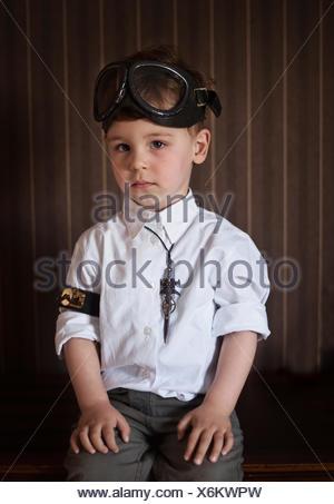 Portrait of a boy wearing steampunk accessories - Stock Photo