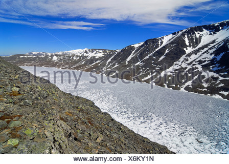Frozen Lake Bessvatnet, Jotunheinem National Park, Vaga, Oppland, Norway, Scandinavia - Stock Photo
