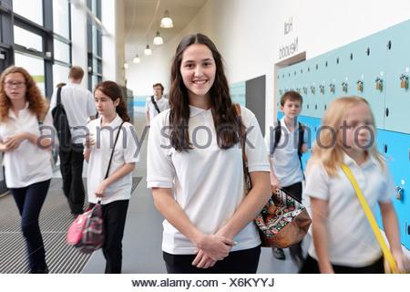 Schoolchildren in school corridor - Stock Photo