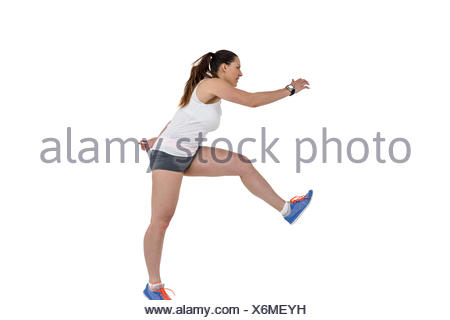 Athlete woman running on white background - Stock Photo