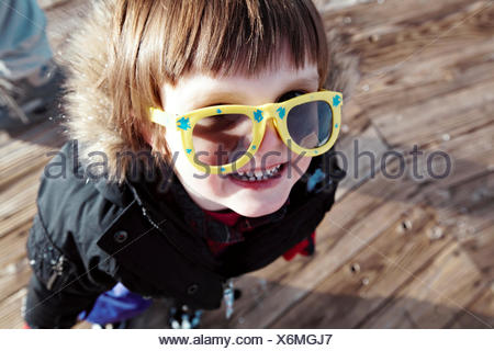 Baby boy (18-23 months) having fun at ski slope - Stock Photo