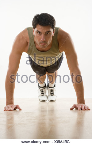 Man doing pushups - Stock Photo