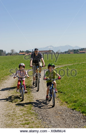 Family on a bicycle ride near Koenigsdorf, Upper Bavaria, Germany, Europe - Stock Photo