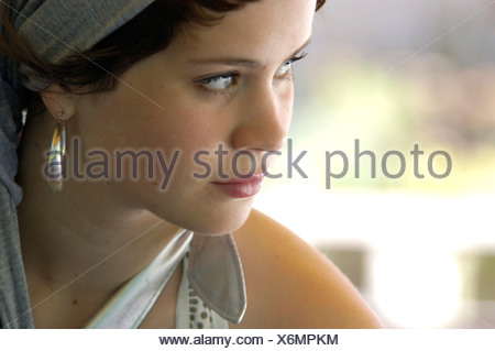 portrait of a beautiful woman with earrings, Germany - Stock Photo