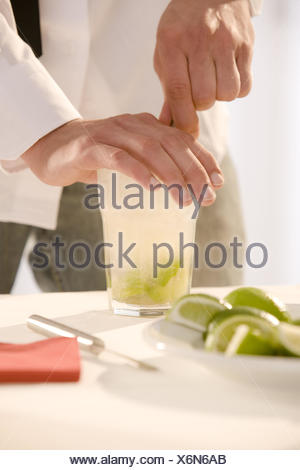 Barkeepers, detail, hands, cocktail, Caipirinha, prepare, stir, - Stock Photo