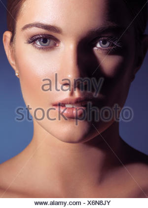 Face of a woman with natural makeup and spotless skin - Stock Photo
