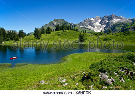 Koerber Lake in summer with cloudless sky, Austria, Vorarlberg, Hochtannbergspass - Stock Photo