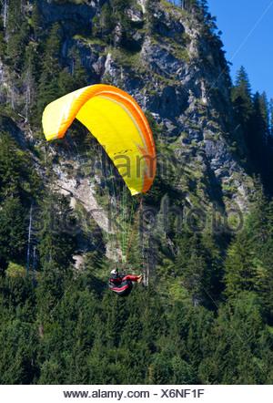 Paraglider landing in front of Tegelberg Mountain, Upper Bavaria, Bavaria, Germany, Europe, PublicGround - Stock Photo