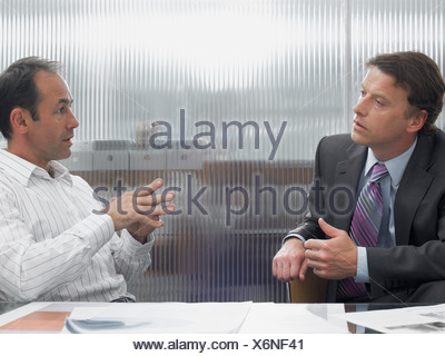 Businessmen in a meeting - Stock Photo