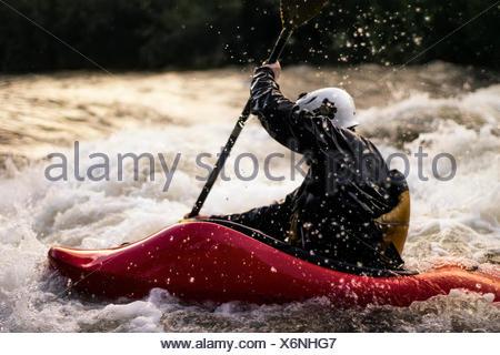 USA, Colorado, Clear Creek, Close-up shot of man kayaking in white water - Stock Photo