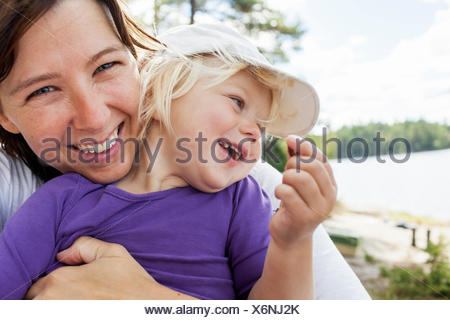 Sweden, Vastergotland, Vattlefjall nature reserve, Mother holding daughter (2-3) - Stock Photo