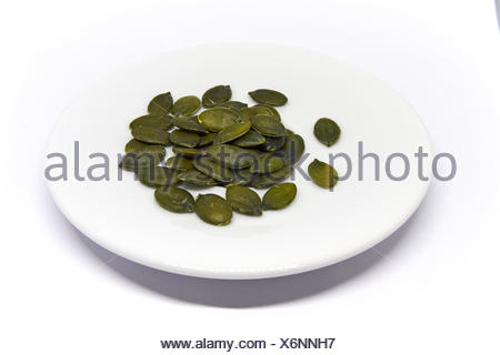 a couple Pumpkin Seeds isolated on white background - Stock Photo