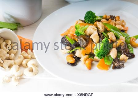 fresh chicken and vegetables stir fried with cashew nuts,typical chinese dish. - Stock Photo