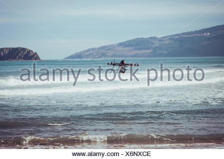Drone flying over sea, Bermeo, Spain - Stock Photo