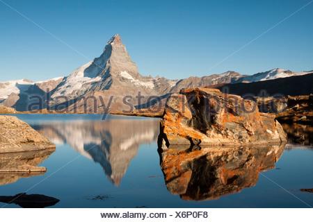 Mt Matterhorn, 4478 m, reflected in Stellisee Lake in the morning, from Stellisee Lake, Canton Valais, Switzerland, Europe - Stock Photo