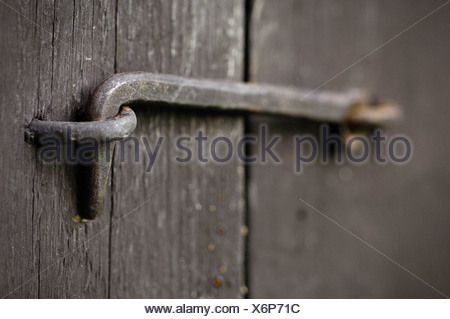 A hasp on a door, Stockholm archipelago, Sweden. - Stock Photo