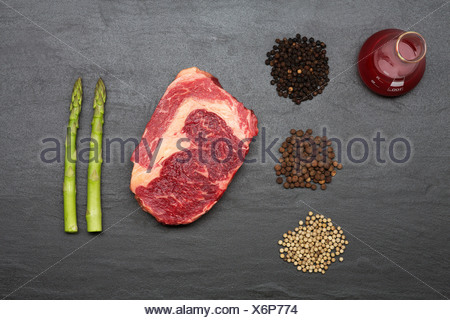 Meat, spices and vegetables on counter - Stock Photo
