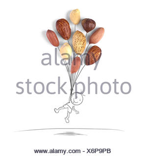 Conceptual boy holding balloons floating mid air - Stock Photo