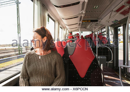 Woman sitting on a train - Stock Photo
