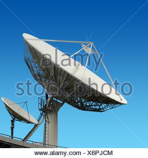 satellite dish aerial antenna clouds dish rooftop satellite sky big radio electronics  - Stock Photo