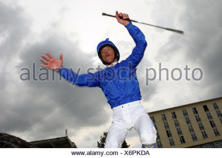 Hamburg, Germany, Jockey Lanfranco Dettori makes a caper - Stock Photo