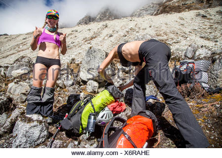 Expedition members changing their clothes and packing. - Stock Photo