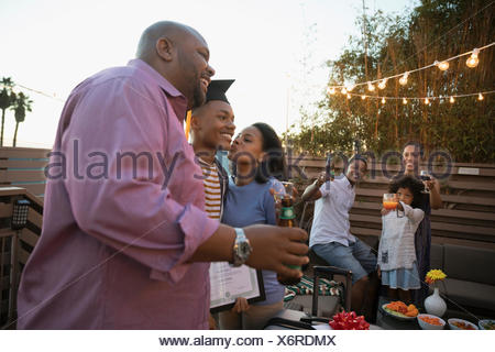 Affectionate African American parents celebrating son - Stock Photo