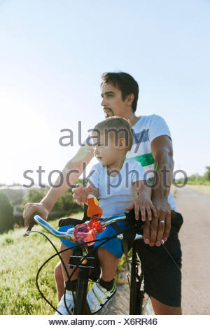 Little boy on bicycle tour with his father - Stock Photo
