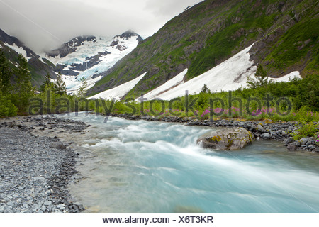 Byron Glacier and river near the Portage Glacier in the Chugach Mountains, Kenai Peninsula, Alaska, USA - Stock Photo