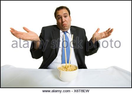 Businessmen eating noodles - Stock Photo