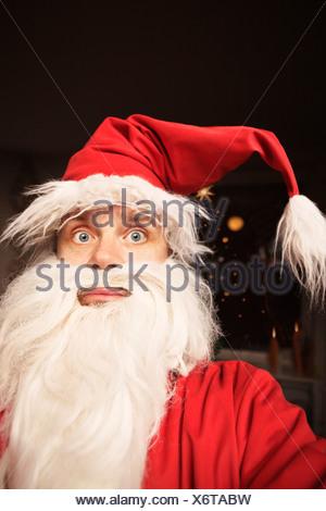 Man wearing Santa Claus suit - Stock Photo