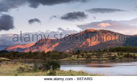 Mam na Gualain and Beinn na Caillich, two of the mountains on the north bank of Loch Leven, in evening light, Loch Leven - Stock Photo