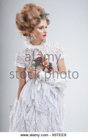 Fashion Model in Flossy White Dress and Wreath of Flowers - Stock Photo