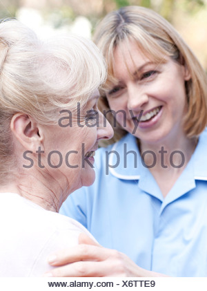 Nurse on a home visit - Stock Photo
