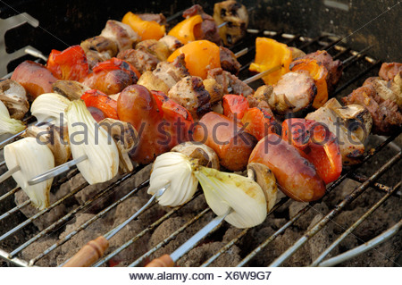 Close-up of meat skewers on the grill - Stock Photo