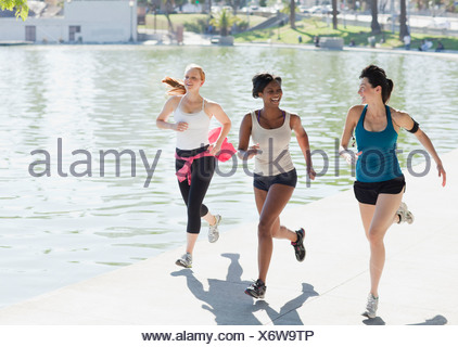 Women jogging together in park - Stock Photo